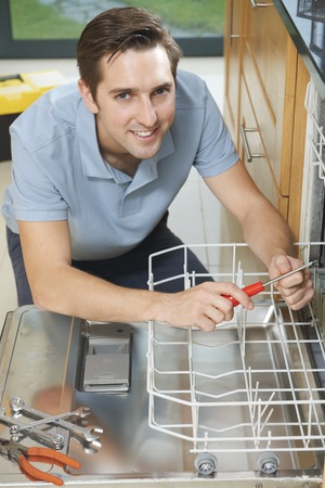 dishwasher being fixed