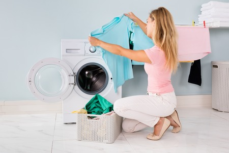 checking clothes from dryer